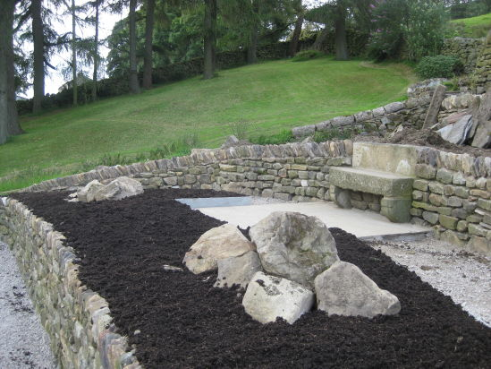 Topsoil into the flower beds