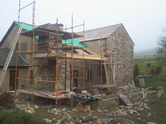 Stone facing in progress